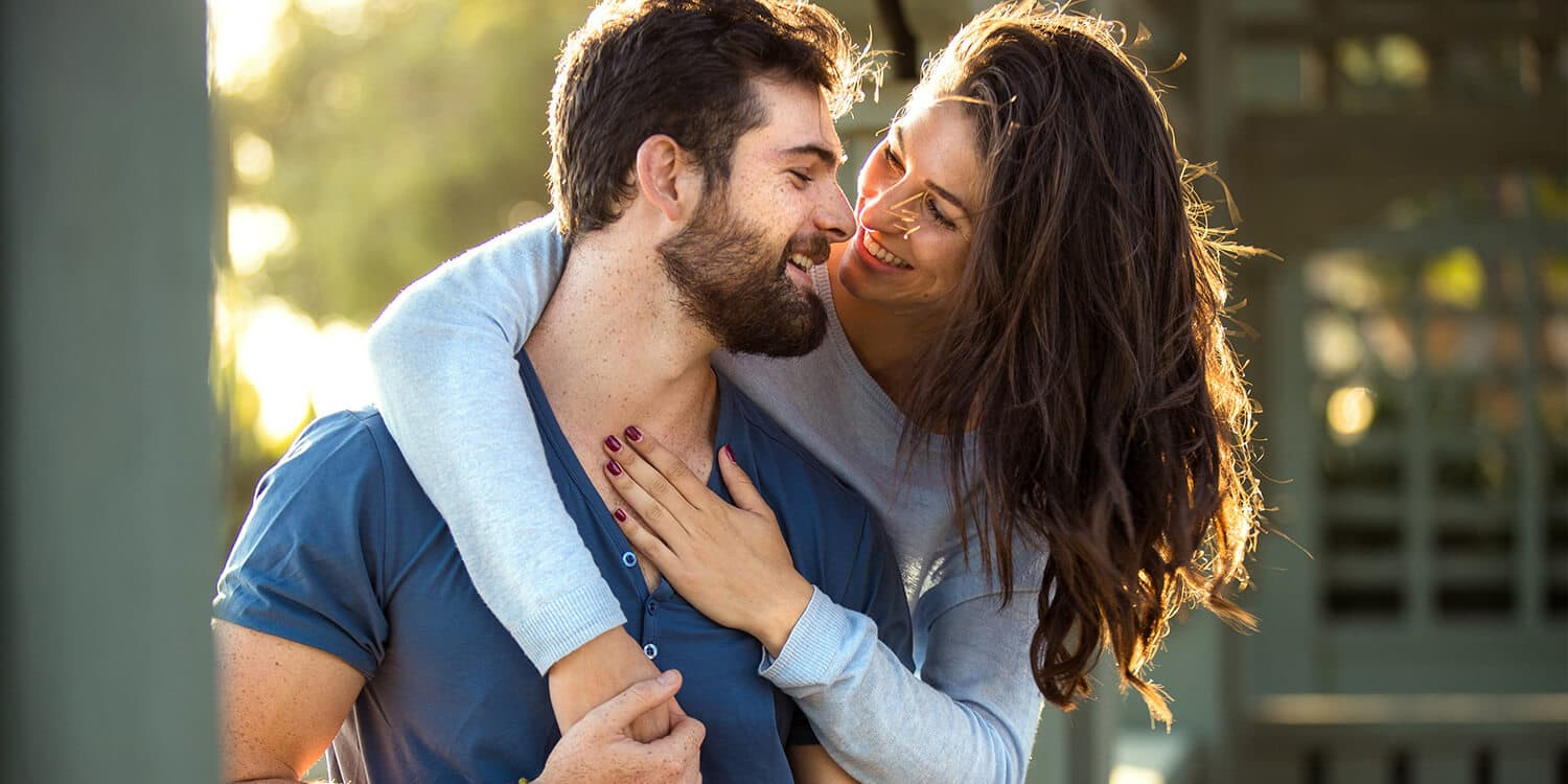 woman hugging  man and smiling