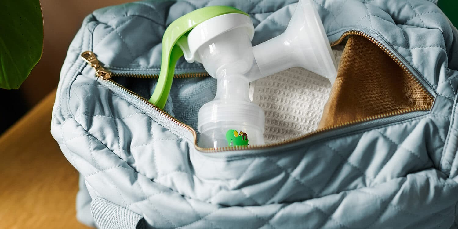 Open baby changing bag with manual breast pump